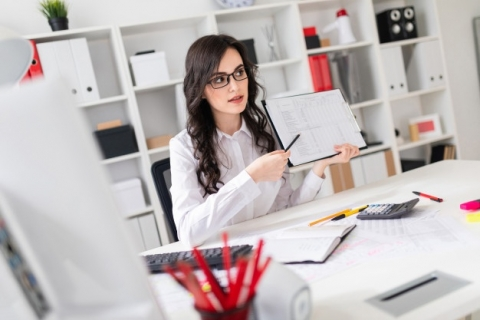 beautiful-young-girl-is-sitting-table-office-pointing-pencil-information-document_88135-11583